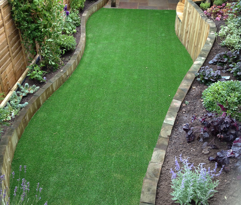 Artificial lawn in courtyard garden Ightham Kent