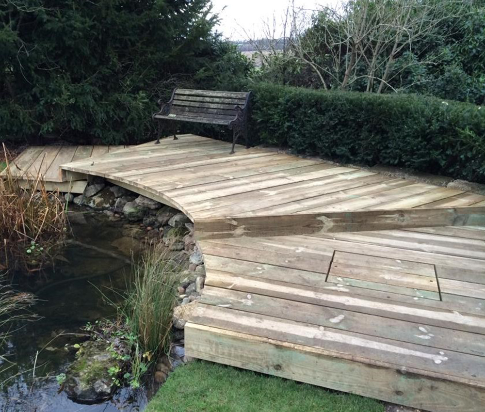 Raised decking seating area around a pond Plaxtol Kent