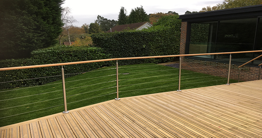Contemporary decking with stainless steel balustrade for safety, Ightham, Kent