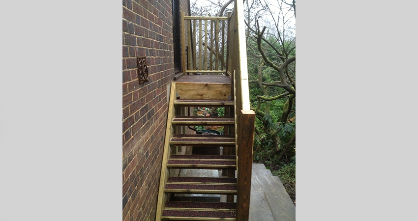 External timber staircase with anti slip rubber in layed decked treads. Ightham, Kent