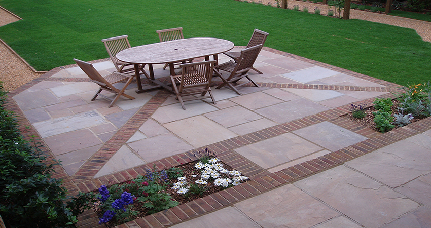 Formal Indian sand stone patio with diagonal brick inlay and surround. Sevenoaks, Kent