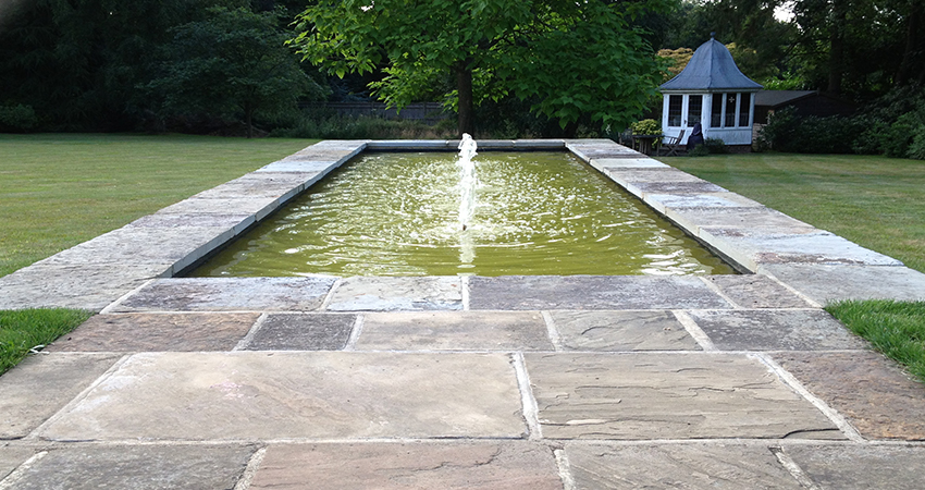 Formal ornamental pond fibreglass lined with reclaimed York stone surround. Bitchet Green, Seveonaks, Kent