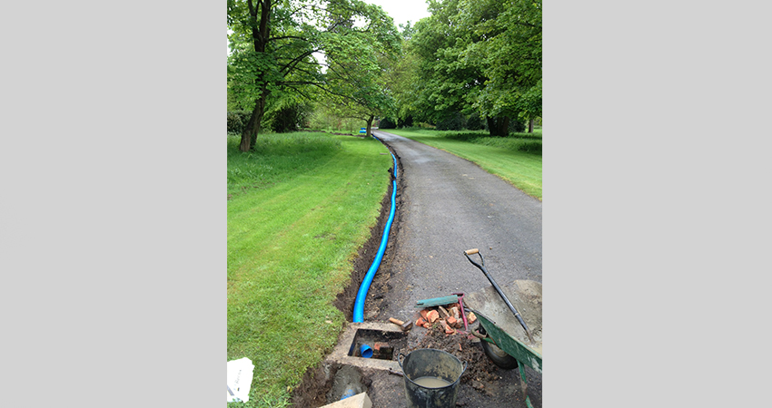 French drain installation for Driveway. Seal Chart, Kent