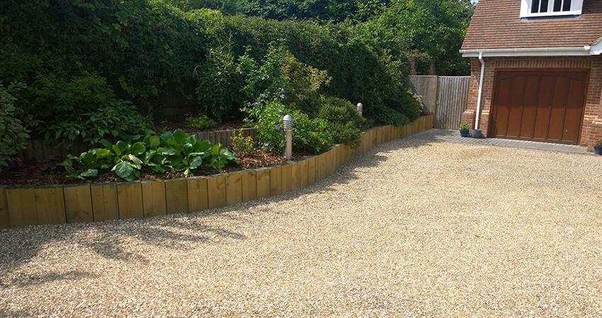 Gravel driveway with terraced sleeper retained wall. West Malling, Kent