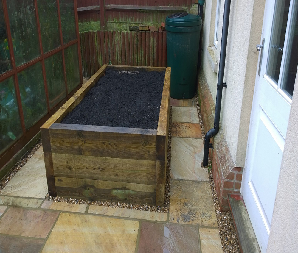 Great use of a courtyard to add a raised herb bed outside your back door at a property Sevenoaks Kent