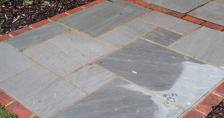 Grey Indian sand stone with brick edge surround. Weald, Sevenoaks, Kent