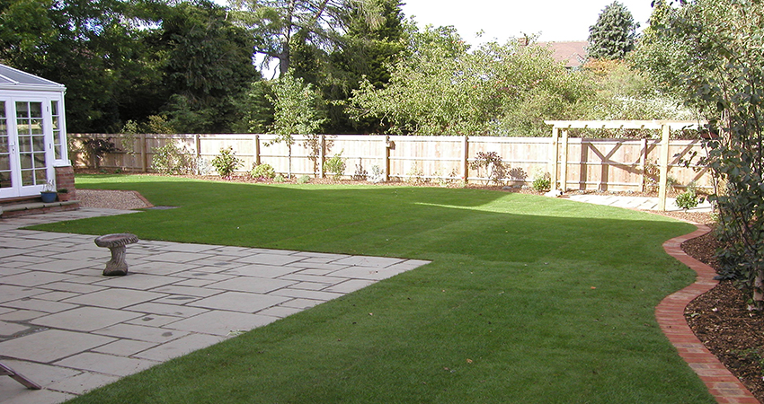 Lawned rear garden with birck edge surround. West Malling, Kent