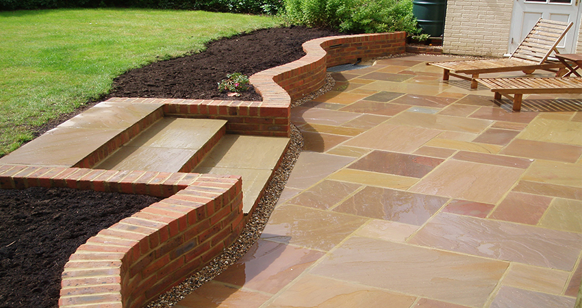 Meandering brick retaining wall incorporating steps. South Godstone, Surrey