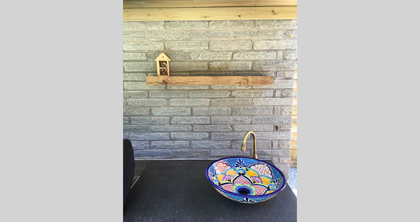 Mexican sink is a great addition to a working outdoor kitchen with a Kandla Indian Sand Stone walling splashback. Seal, Sevenoaks, Kent