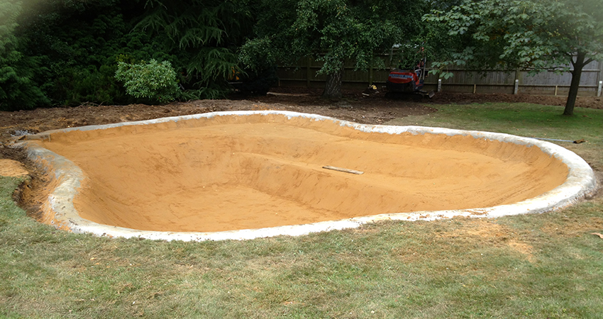 Mid construction of nature pond with a sand screed  prior to laying pond liner. Bitchet Green, Sevenoaks, Kent