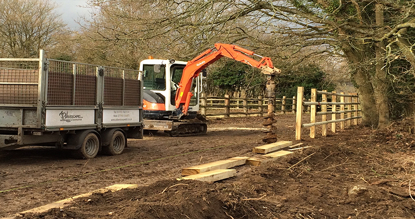 Mid construction of post & rail fencing using post boring tool. Ightham, Kent