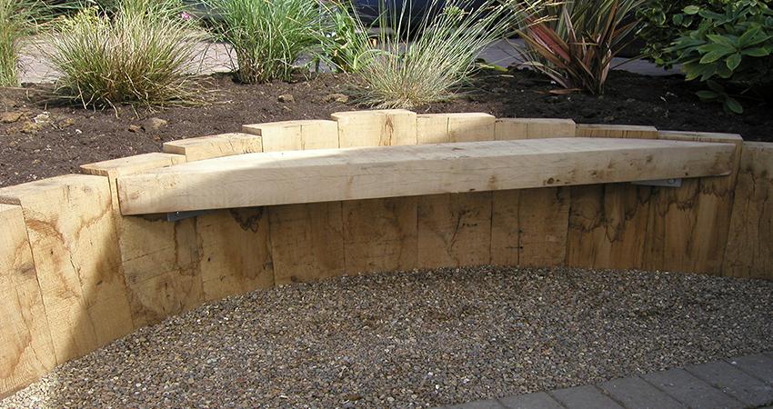 New Oak vertical sleeper walling incorporating seat. Maidstone, Kent