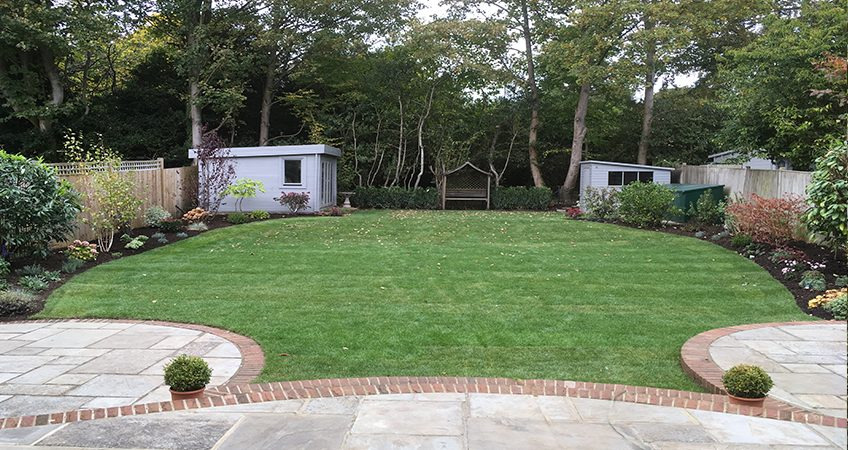 Newly laid lawn with shrub herbaceous borders Sevenoaks Kent