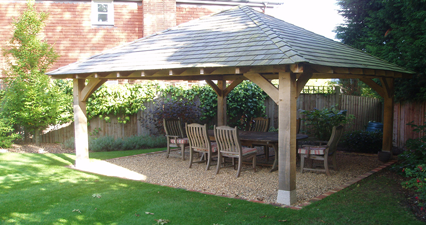 Oak framed Gazebo with Cedar shingle roof making a relaxing eating area, Plaxtol, Kent
