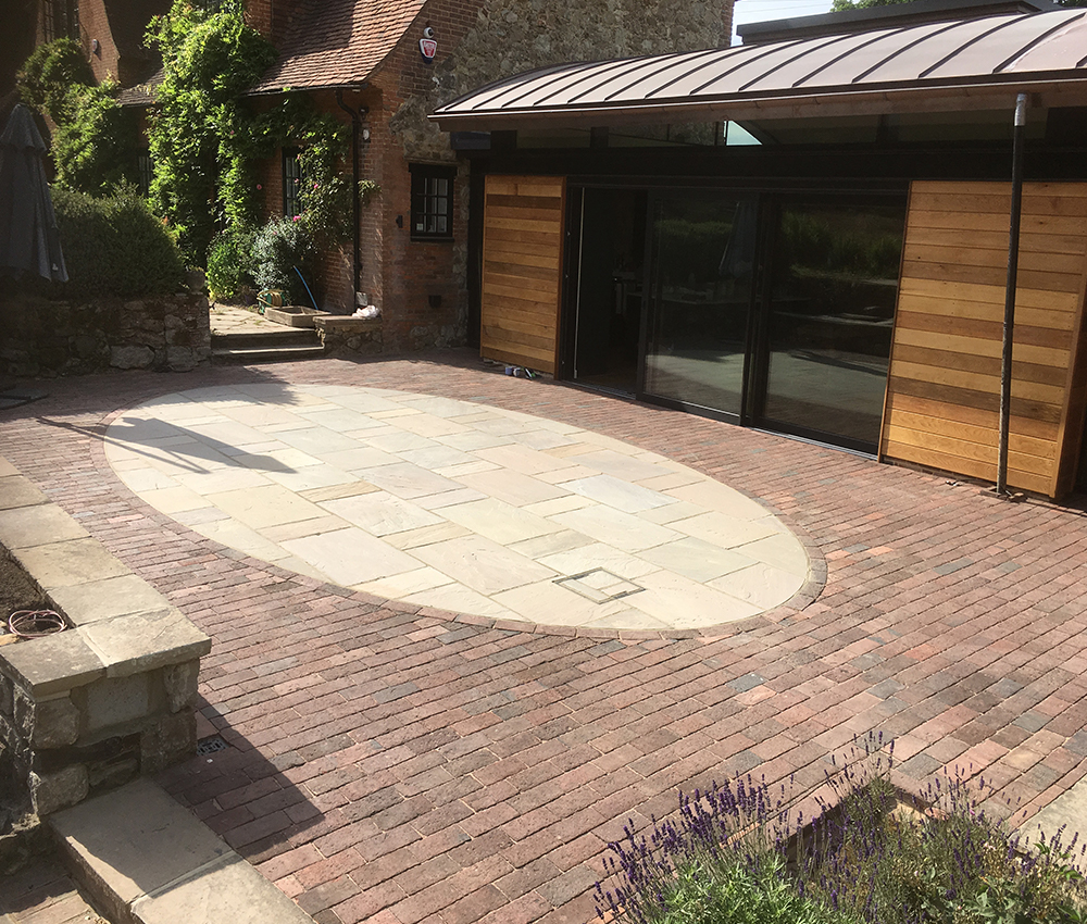 Oval Indian sand stone patio with Victorian brick paving surround Seal Chart Sevenoaks