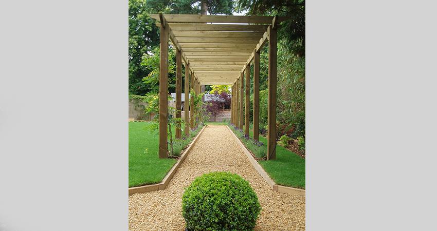Pergola avenue in landscaped garden, Sevenoaks, Kent
