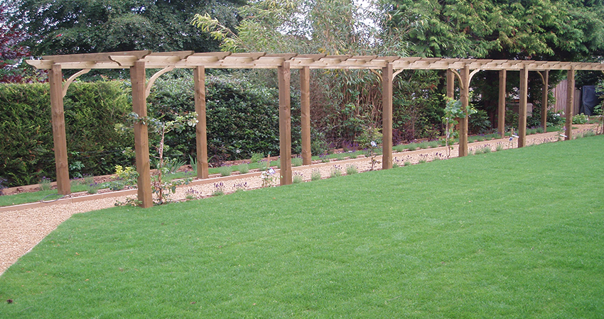 Pergola walkway with gravel path ideal to train climbers across, Sevenoaks, Kent