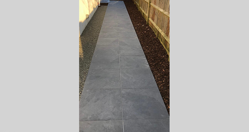 Porcelain side pathway using decorative shingle and ornimental bark edging. Ightham, Kent