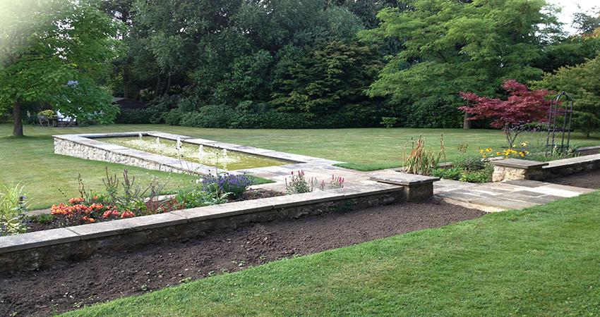Raised Rag stone walled formal pond. Bitchet Green, Sevenoaks, Kent