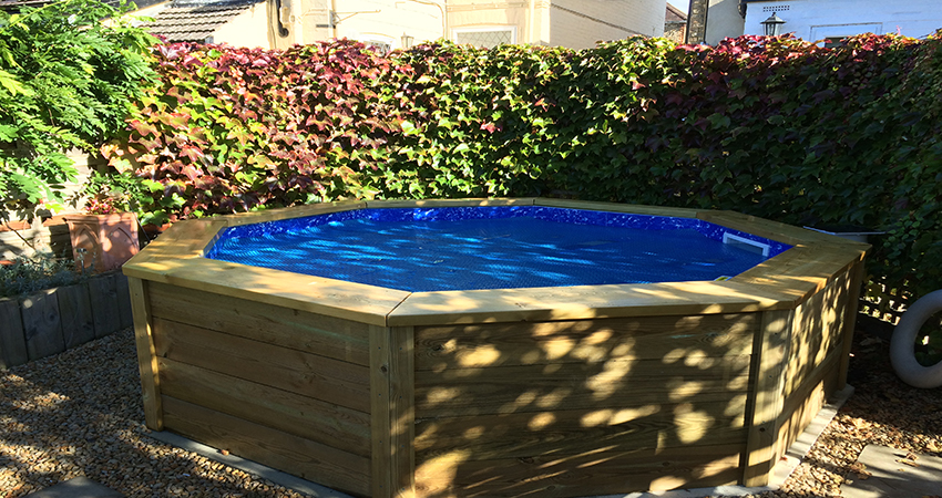 Raised Softwood sleeper heated pool to cool off in the Summer sun. Kemsing, Kent
