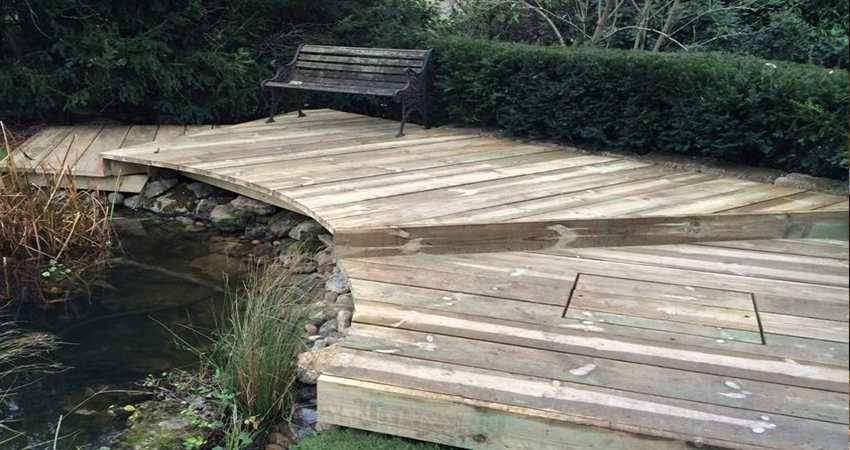 Raised decking seating area around a pond, Plaxtol, Kent