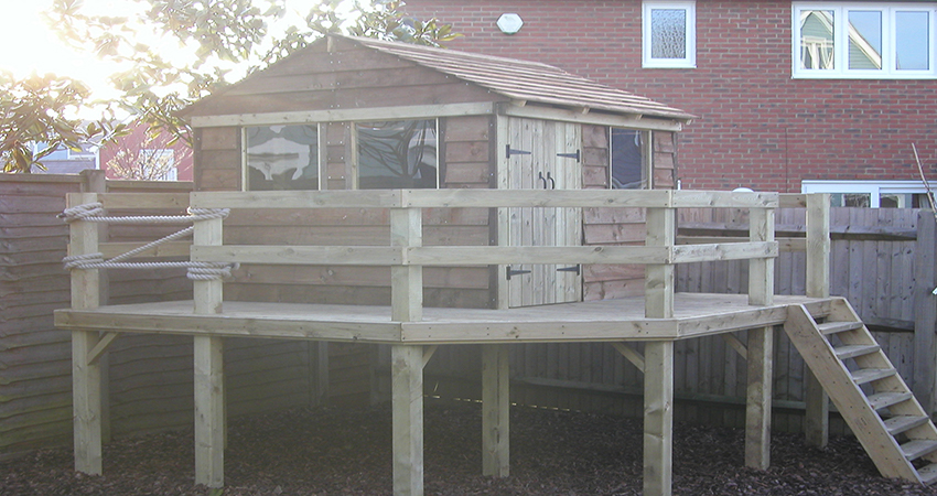 Raised playhouse with veranda. Larkfield, Kent