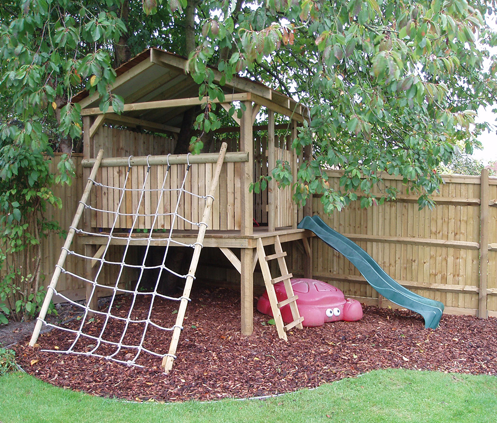 Roofed treehouse with cargo net and slide Kemsing Kent