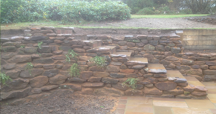 Sand and Iron stone walling incoperating steps to upper lawn. Borough Green, Kent