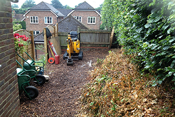 Site clearance of side garden in preperation for landscaping with Artificial lawn and sleeper walling Ightham Kent