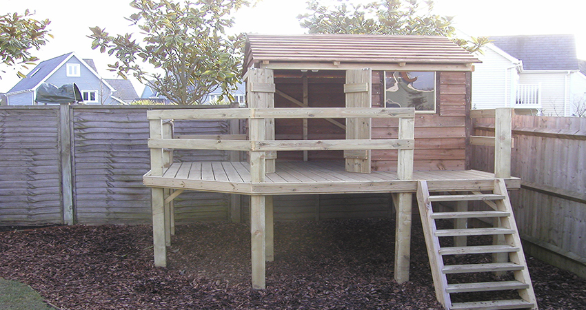 Small raised roofed playhouse with veranda and steps... giving Children hours of fun!. Larkfield, Kent