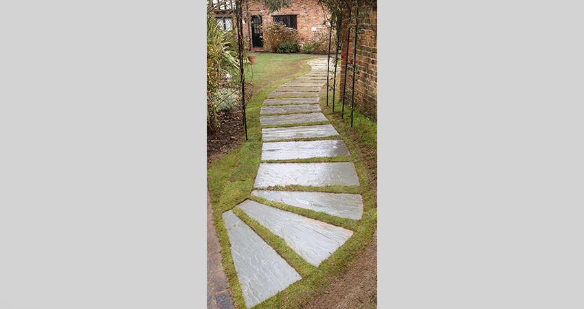 Stepping stone inlaid to lawn. Brasted, Kent