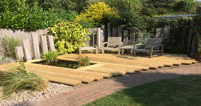 Sun trap deck with tranquil pond. Otford, Kent