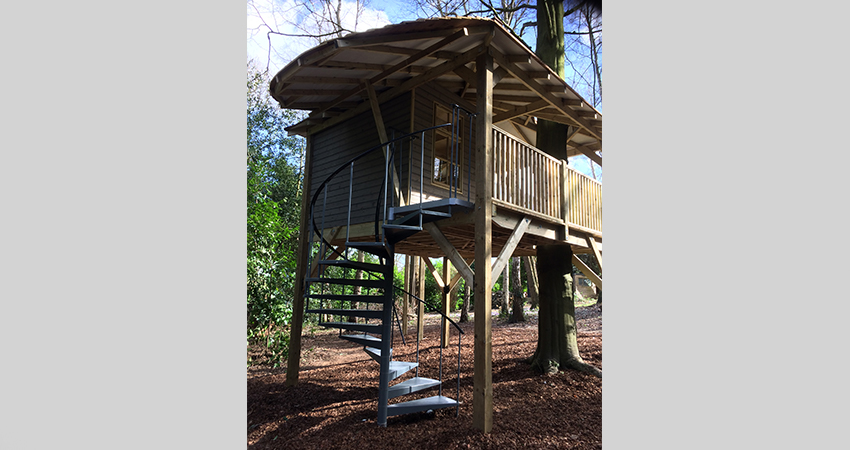 Treehouse with steel spiral staircase. Aylesford, Kent