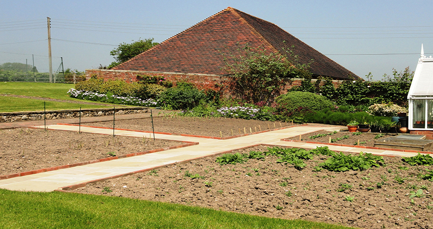 Victorian kitchen garden with large planting areas producing a high yield crop. Plaxtol, Kent